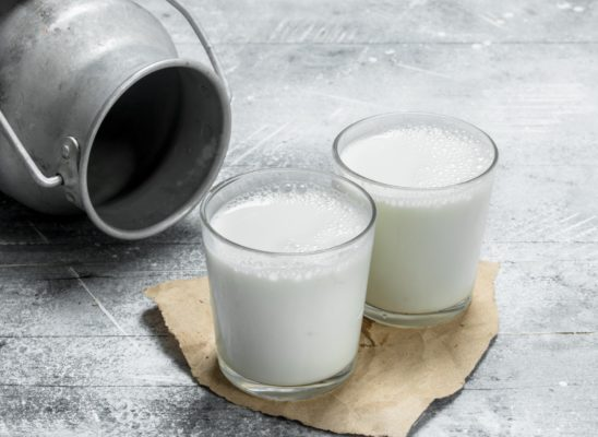 Milk in glasses with a can.