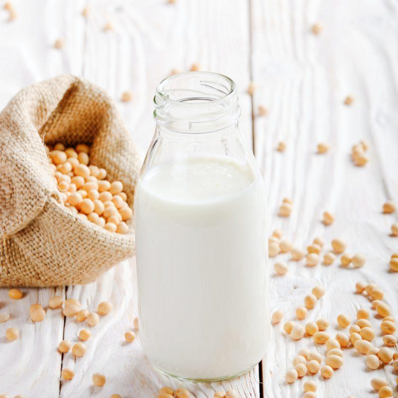 Non-dairy alternative Soy milk or yogurt in glass bottle on whit